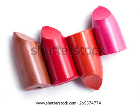 close up of four slice lipstick on white background