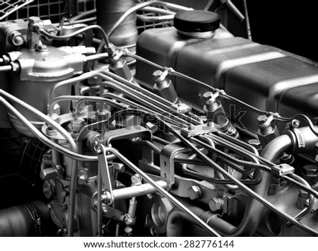 Close up of fragment of automobile engine, black and white image - stock photo