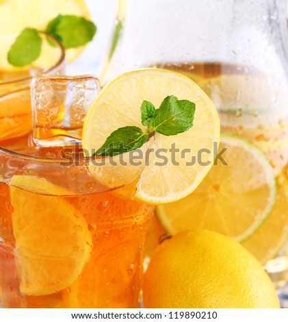 Close up of fresh and cold ice tea with sliced lemon and mint - stock photo