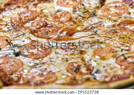 Close-up of fresh and tasty Margherita pizza