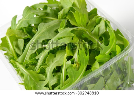 close up of fresh arugula package