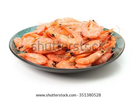Close up of fresh boiled tiger shrimp isolated on white background - stock photo