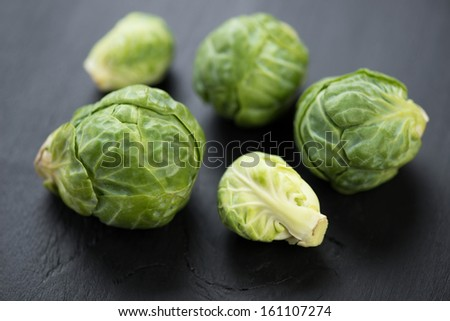 Close-up of fresh brussels sprouts, horizontal shot - stock photo