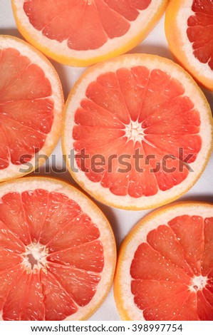 Close up of  fresh citrus slices; grapefruit texture
