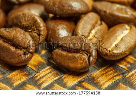 close up of fresh coffee beans on bamboo plate and  ready to brew delicious coffee