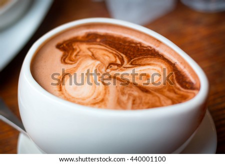 Close up of fresh creamy cup of Hot Chocolate. Cup of hot chocolate. Mug of hot Chocolate - stock photo