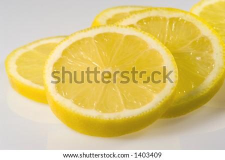 Close up of fresh lemon slices - stock photo
