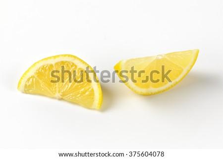 close up of fresh lemon slices on white background - stock photo