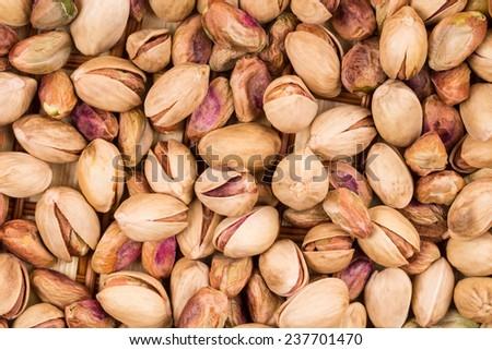Close up of fresh pistachios. Whole background. - stock photo