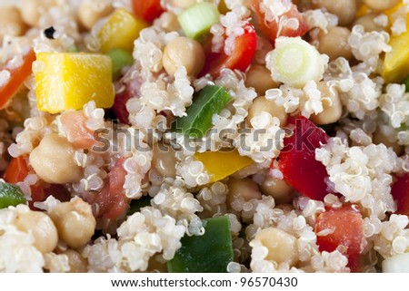 Close up of fresh quinoa salad with bell peppers and chickpeas. - stock photo