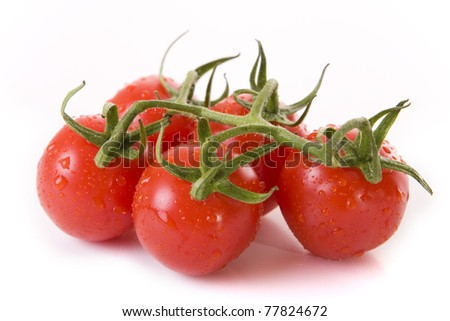 Close up of fresh red tomatoes on a white background