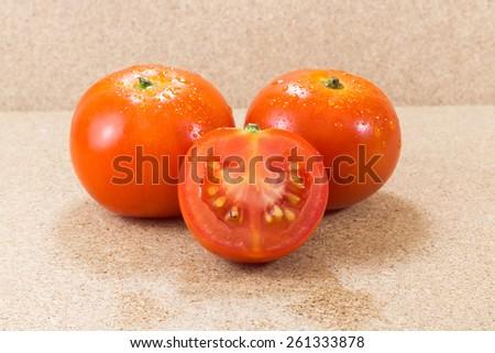 Close-up of fresh, ripe cherry tomatoes on wood - stock photo