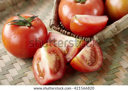 Close-up of fresh, ripe tomatoes on Baskets background