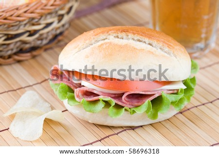 Close up of fresh sandwich with veggies and meat - stock photo