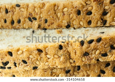 Close-up of Fresh sliced wholewheat bread with various seeds and multigrain