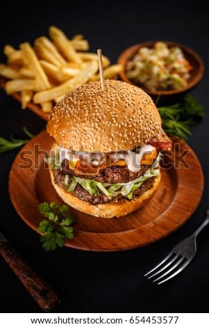 Close up of fresh tasty burger with french fries