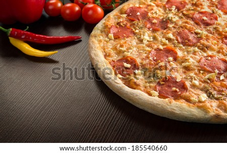 Close up of fresh tasty pizza with copy space - stock photo
