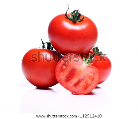 Close up of fresh tomatoes over white background - stock photo
