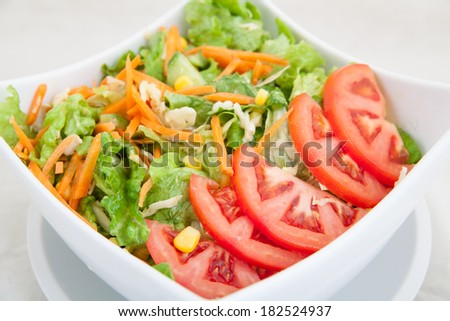 close-up of fresh vegetable salad with tomatoes and carrots