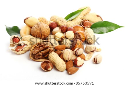Close up of fresh walnuts and hezelnuts against white background