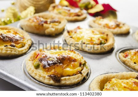 Close up of freshly baked Christmas vegetable and cheese tart - stock photo
