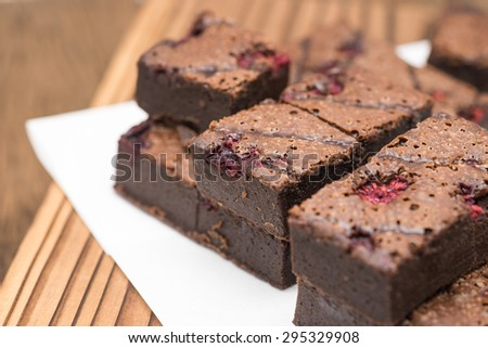 Close up of freshly baked dark brownie chocolate for dessert background - stock photo