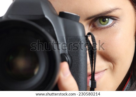 Close up of front view of a photographer woman eye photographing with a dslr camera - stock photo