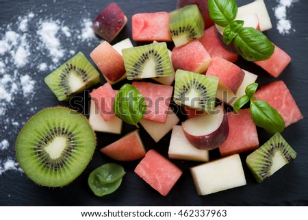 Close-up of fruit salad with watermelon, kiwi, melon and peaches