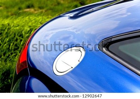 Close-up of fuel filler cap and car body - stock photo