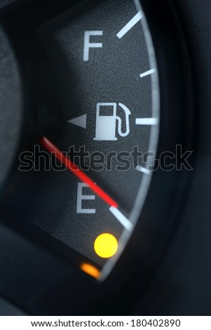 Close up of fuel gauge on empty - stock photo