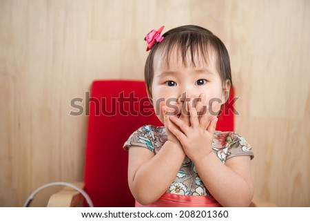 Close up of funny baby girl - stock photo