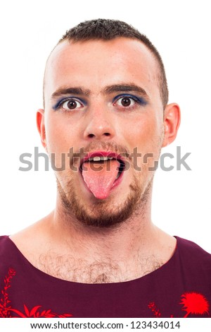 Close up of funny transvestite man sticking out tongue, isolated on white background.