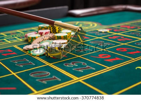 Close up of gambling chips on green table in casino.  - stock photo