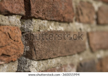 close up of gap in old brick wall. artistic limited focus and blur. room for text.