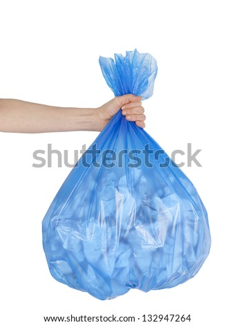 Close up of garbage bag holding by hand - stock photo