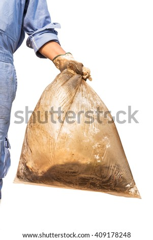Close up of garbage-bag holding by hand - stock photo