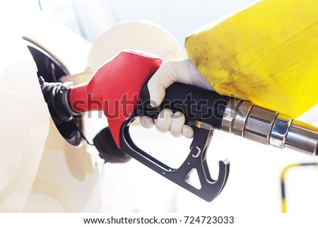 close up of gas gun with car