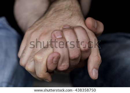 Close-up of Gay Men Holding Hands