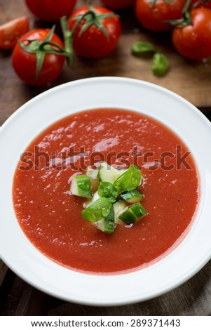 Close-up of gazpacho with cucumber and green basil topping