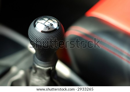 Close up of gearsift of a sportive car - stock photo