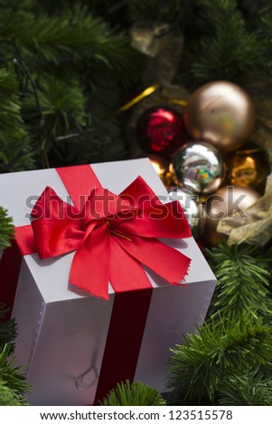 close up of gift and decorated christmas tree