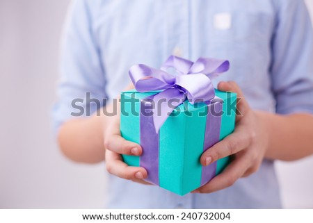 Close-up of gift box in hands - stock photo