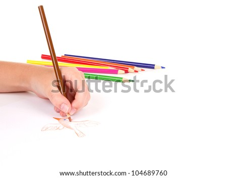 Close-up of girl drawing a bird with colored pencils - stock photo