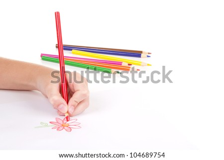 Close-up of girl drawing a flower with colored pencils - stock photo