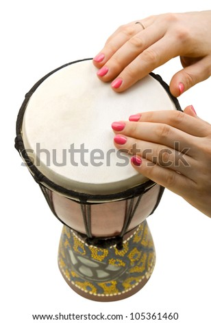 Close-up of girl drummers hands playing percussion isolated on white - stock photo