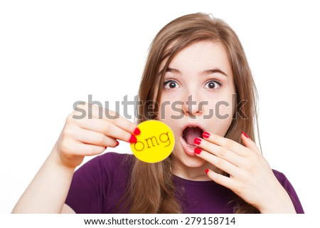 Close-up of girl reacting surprised, holding up an omg sign, isolated on white.