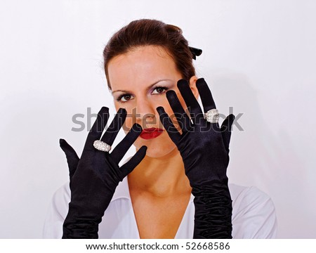 Close up of girl with black satin gloves - stock photo