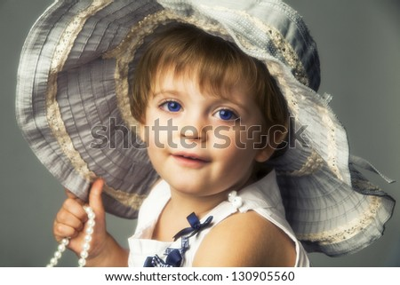 Close-up of girl with hat of fabric. - stock photo