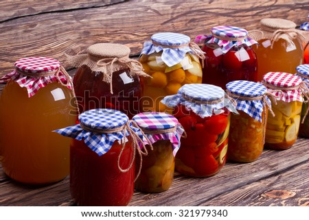 Close-up of glass jars with preservation. Natural food. - stock photo