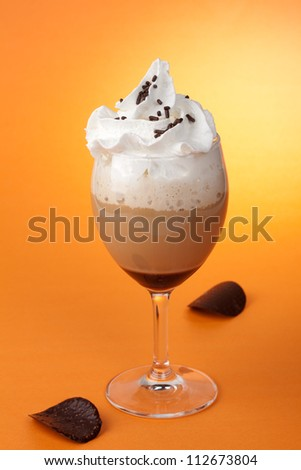 Close up of glass of fresh, delicious Chocolate Vanilla Coffee Cocktail, and Dark Chocolate Crisps - stock photo